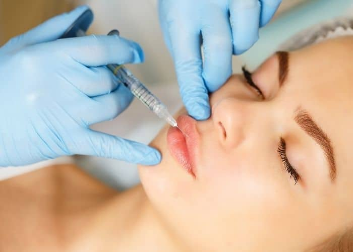 Restylane injecting into the lips